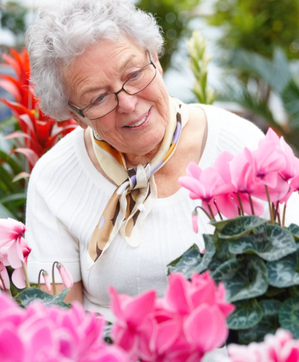 elder woman with flowers