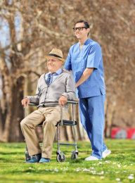 caregiver assisting an old man