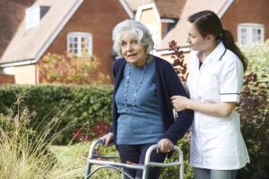 caregiving assisting senior woman